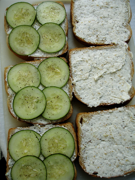 Put the tops on the sandwiches. Using a sharp chef's knife, remove ...